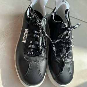 Chanel black leather white laces sneakers